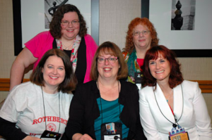Clare, in front row, wearing a Black Hour shirt on her Malice Domestic panel. A very good friend.